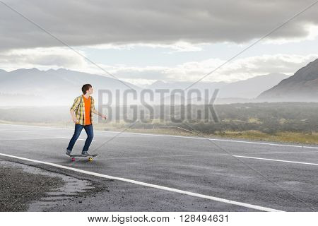 Boy ride skateboard