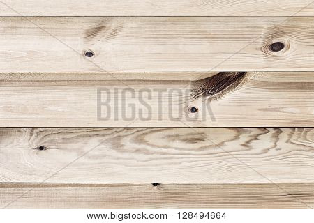The light brown plank. The wood texture. The background. The horizontal plank.