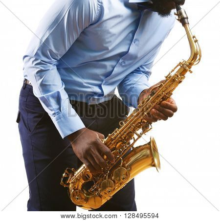 African American jazz musician playing the saxophone, isolated on white