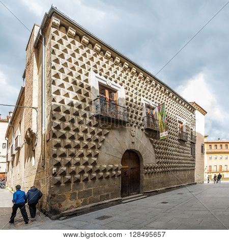 SEGOVIA,SPAIN - APRIL 22,2016 - House Los Picos is most notable for its facade which is covered entirely by pyramid-shaped granite blocks. The building dates back to the 15th century.