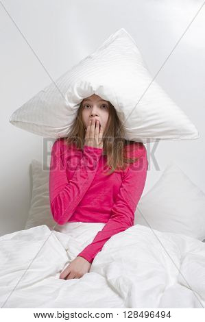 Yawn Girl With A Pillow Over His Head..