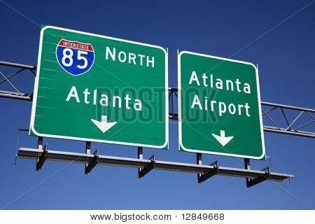 Freeway signs directing drivers to the Atlanta airport. Horizontal shot.