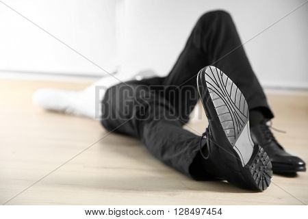 Tired businessman lying on the floor