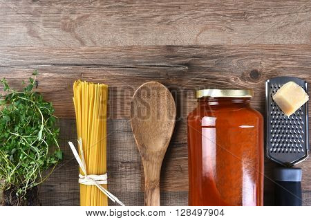 The components for making a traditional Italian Spaghetti dinner. Top view with copy space.