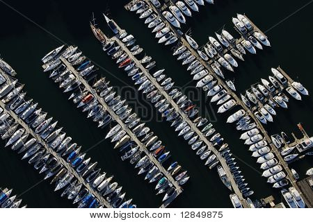 Aerial view of boats lined up on the piers at a marina. Horizontal shot.