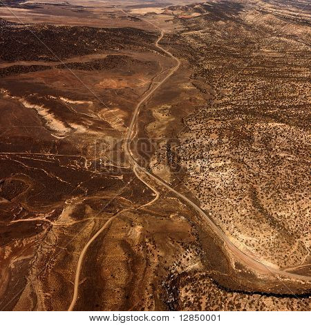Aerial view of a of rural, desert landscape with roads running through it. Square shot.