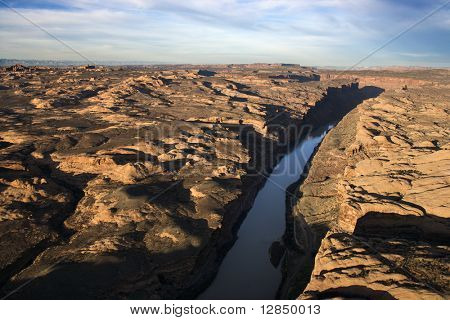 River carved through a rocky, desert landscape. Horizontal shot.