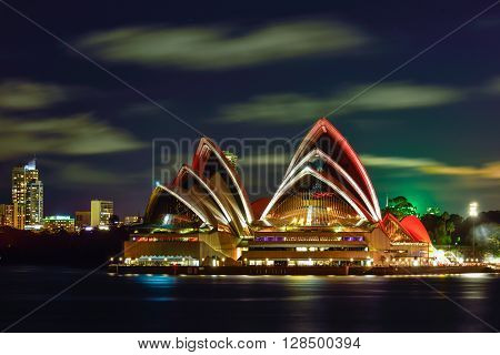 Long exposure of SYDNEY AUSTRALIA - August, 8, 2016: View of Sydney Opera House and with red light celebrate chainese new year in Sydney Australia Over 10 millions tourists visit Sydney every year
