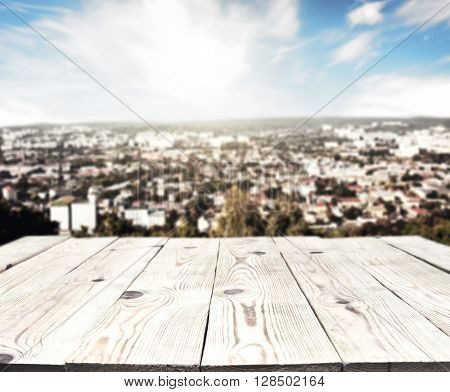 Old wooden table and cityscape on background
