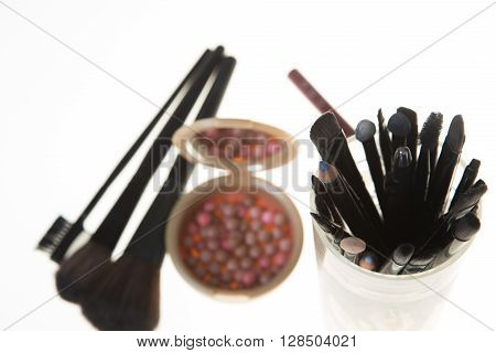 Blush In The Balls And Make-up Brushes Close-up
