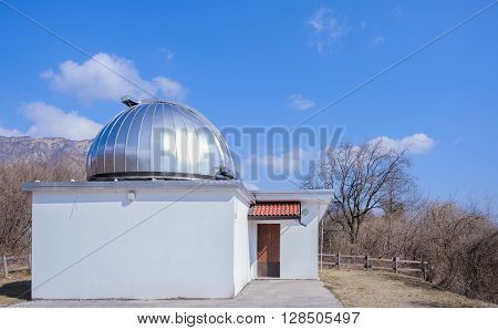 Pordenone,Italy - May 2016 : Astronomical observatory on the blue sky