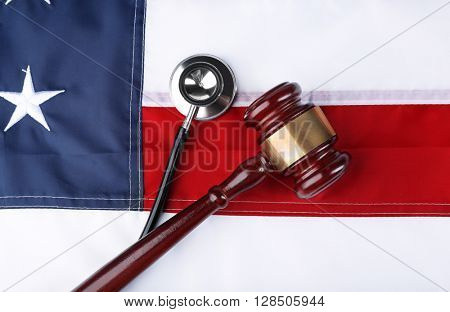 Stethoscope with gavel on background of USA flag