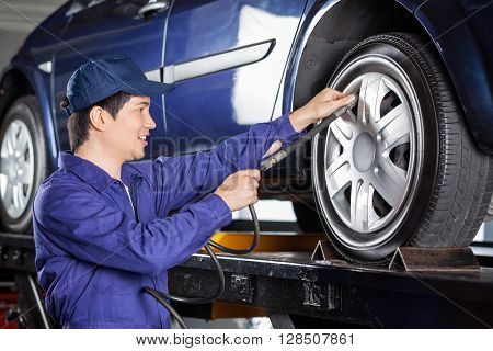Mechanic Inflating Car Tire