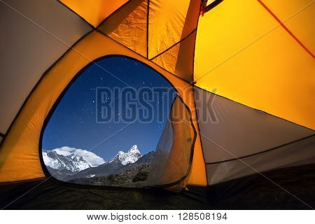 View of the mountains from a tourist tent. From the «window» from left to right there are two eight-thousanders - Mt. Everest (8848 m) Lhotse (8516 m) and Ama Dablam (6814 m).