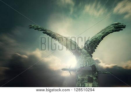 Turul bird with a sword with apocalyptic sky in the Royal Castle, Budapest, Hungary