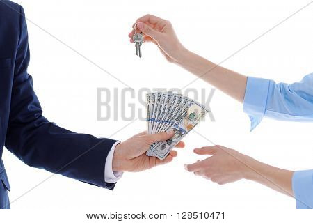 Male and female hands with keys and dollar banknotes, isolated on white