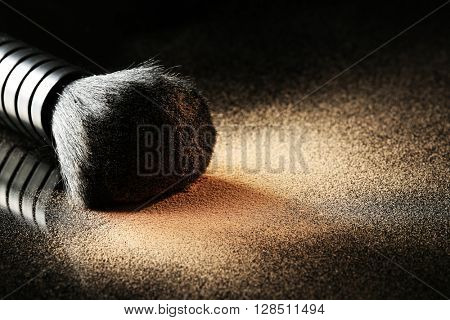 Make up brush with powder, closeup