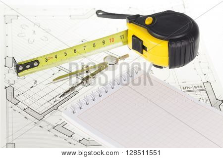 architectural blueprint - house plan, notepad, compass & tape measure