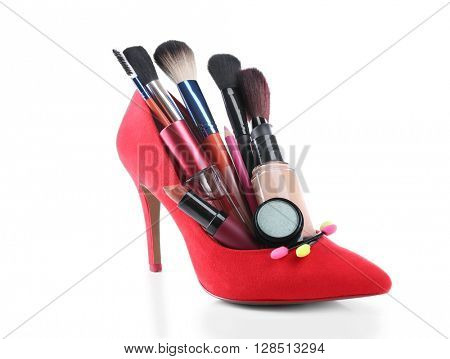 Makeup set with red woman's shoe, brushes and cosmetics, isolated on white