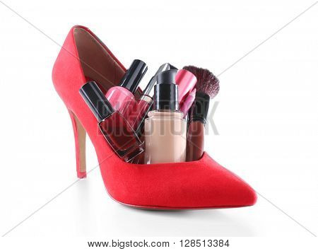 Makeup set with red woman's shoe, brush and cosmetics, isolated on white