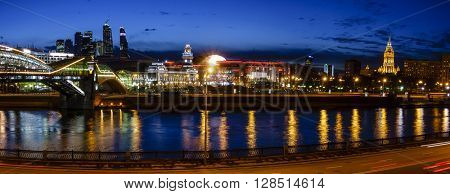 Nighttime panoramic view to Kiev Railway Station and modern Moscow City in Moscow, Russia