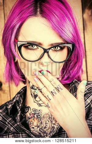Cool girl with bright crimson hair and tattoo on her body. Modern generation. Optics style.