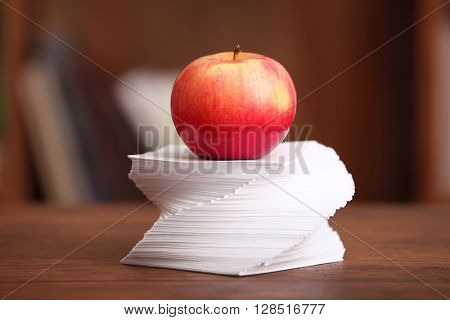 Apple and paper on table in the room