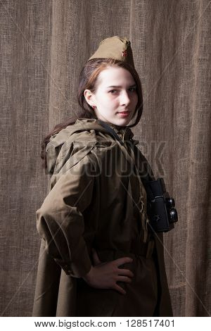 Woman in Russian military uniform with camera. Female war correspondent during the second world war.