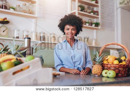 Proud Young Female Juice Bar Owner