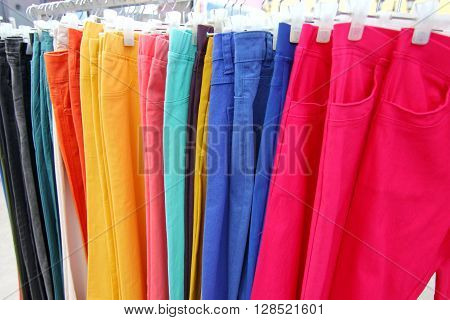 Closed up stacked colorful trousers in the shopping mall