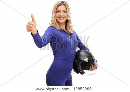 Attractive female car racer holding a helmet and giving a thumb up isolated on white background