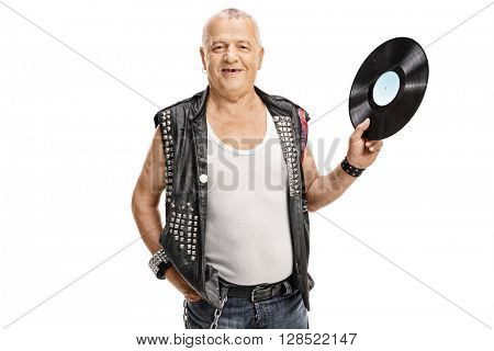 Mature punk rocker holding a vinyl record and looking at the camera isolated on white background