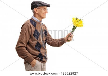 Lovely senior gentleman handing a bunch of tulips to someone isolated on white background