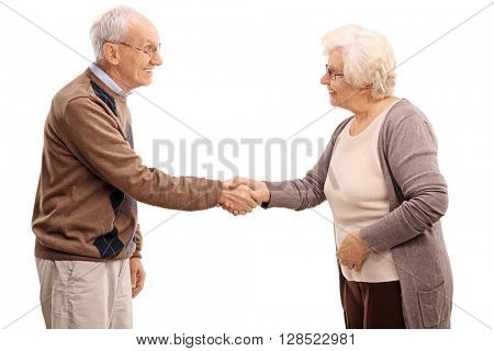 Elderly man and woman shaking hands and smiling isolated on white background