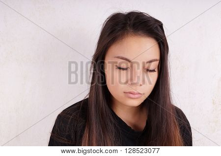crying young asian woman with tears running down her cheeks
