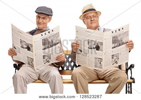 Two senior gentlemen sitting on bench and reading newspapers isolated on white background