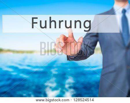 Fuhrung (leadership In German) - Businessman Hand Pressing Button On Touch Screen Interface.