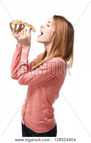Happy young woman eating slice of hot pizza, isolated on white