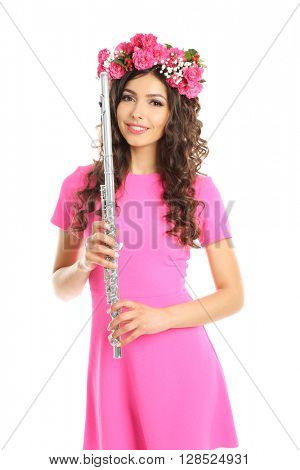 Beautiful young woman with flute isolated on white