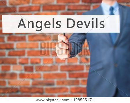 Angels Devils - Businessman Hand Holding Sign