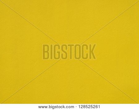 Closeup on yellow cement background. Abstract gold background yellow color vintage grunge background texture gold yellow cement layout design for warm colorful background.