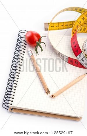 Notebook With Metering Tape, Pencil And Tomatoes On White