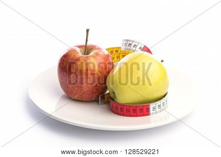 White Plate With Apple And Metering Tape On White