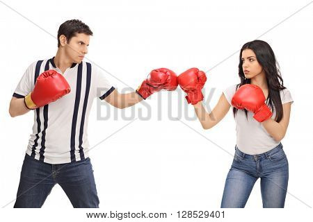 Man and woman with boxing gloves standing opposite of each other isolated on white background