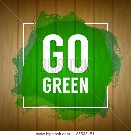 Go green concept. Nature background. Go green design concept. Wood background with paint splash. Wooden texture sign with painted splatter and Go green text. Banner, background, abstract eco banner