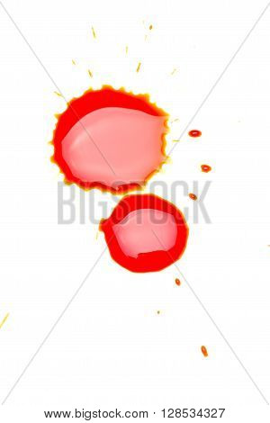 Red chemical liquid drops on white surface