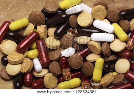 Pills. health concept. antibiotics on wood background