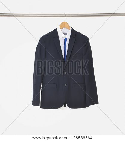 A close up shot of business man suit clothes hanging