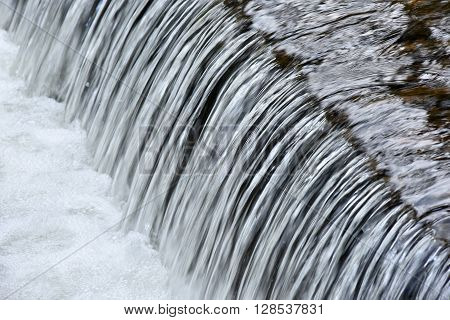 Small cascade with fresh water on a mountain river