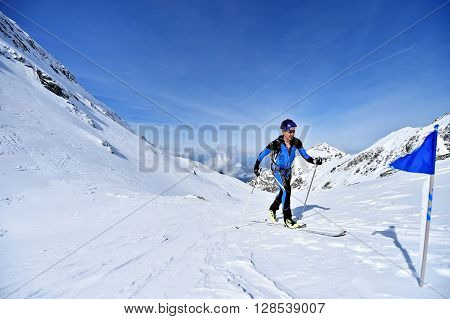 FAGARAS ROMANIA - MARCH 5: Ski mountaineer competes during the Ski Mountaineering National Competition in Fagaras Mountains on March 5 2016 in Romania.